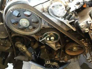 Engine repair timing belt